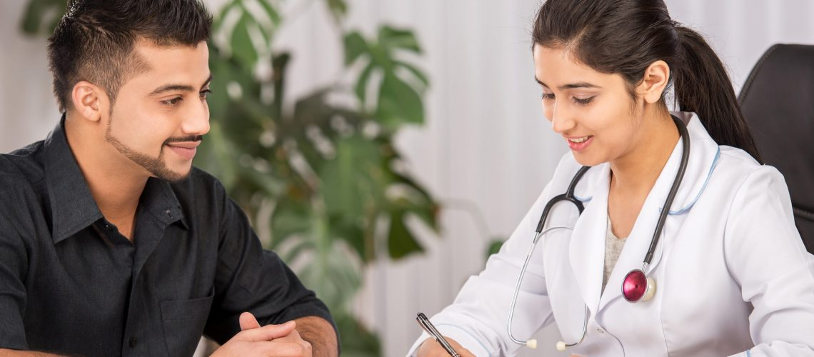 Female Indian physician communication with male patients
